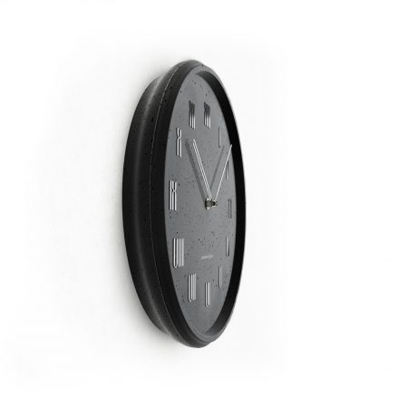 Concrete black wall clock - view from the side