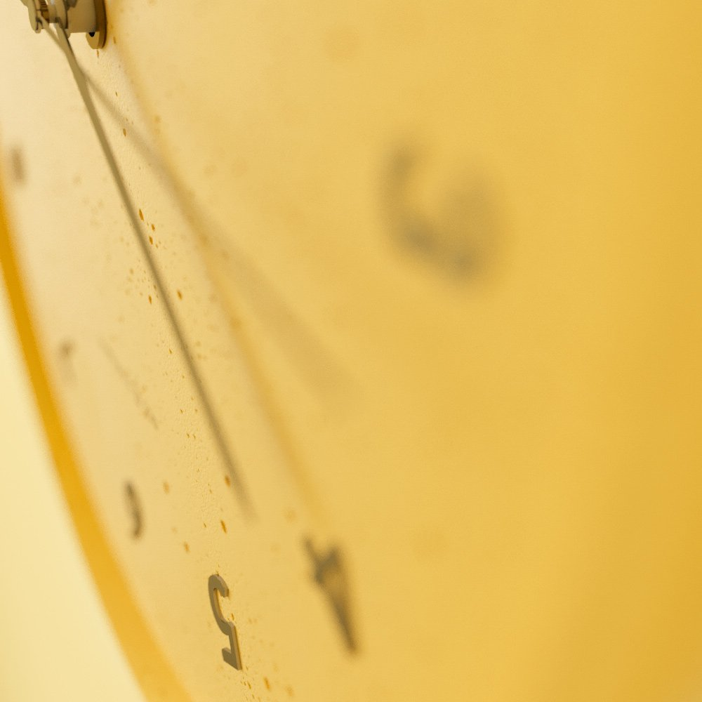 Concrete yellow wall clock - view on details