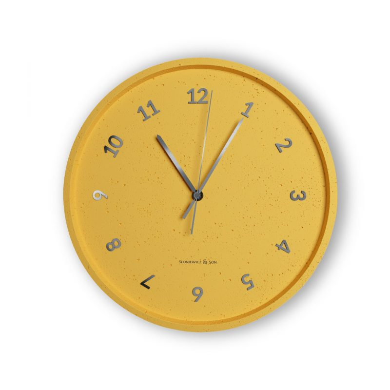 Concrete yellow wall clock - front view